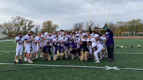 Purples celebrate after winning semi-state against Northern Pulaski 20-12.